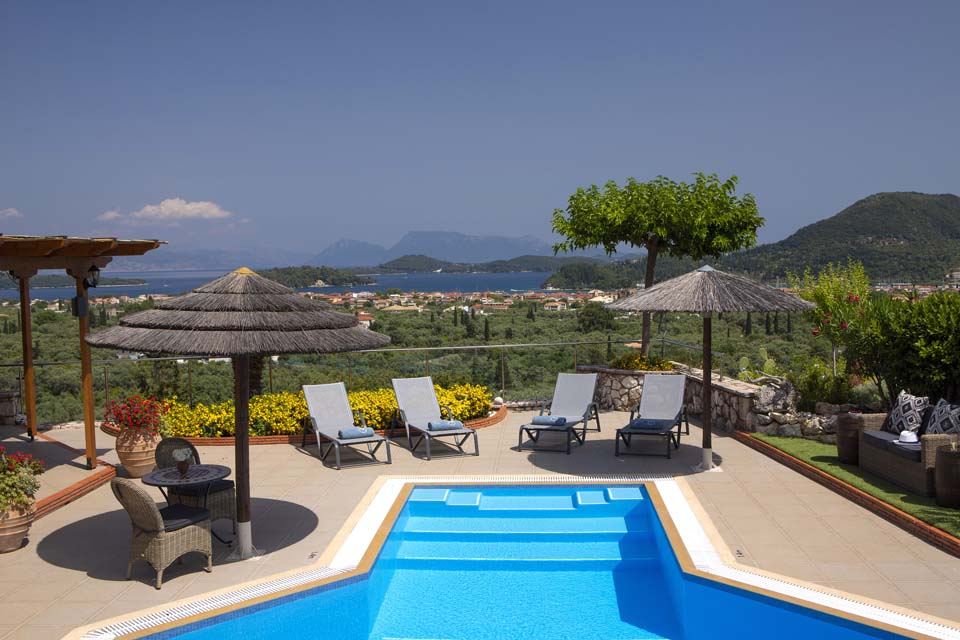 Villa Octavius pool, sun loungers and view to the Ionian Islands