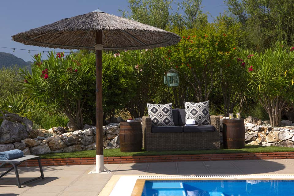 Poolside seating at Villa Octavius