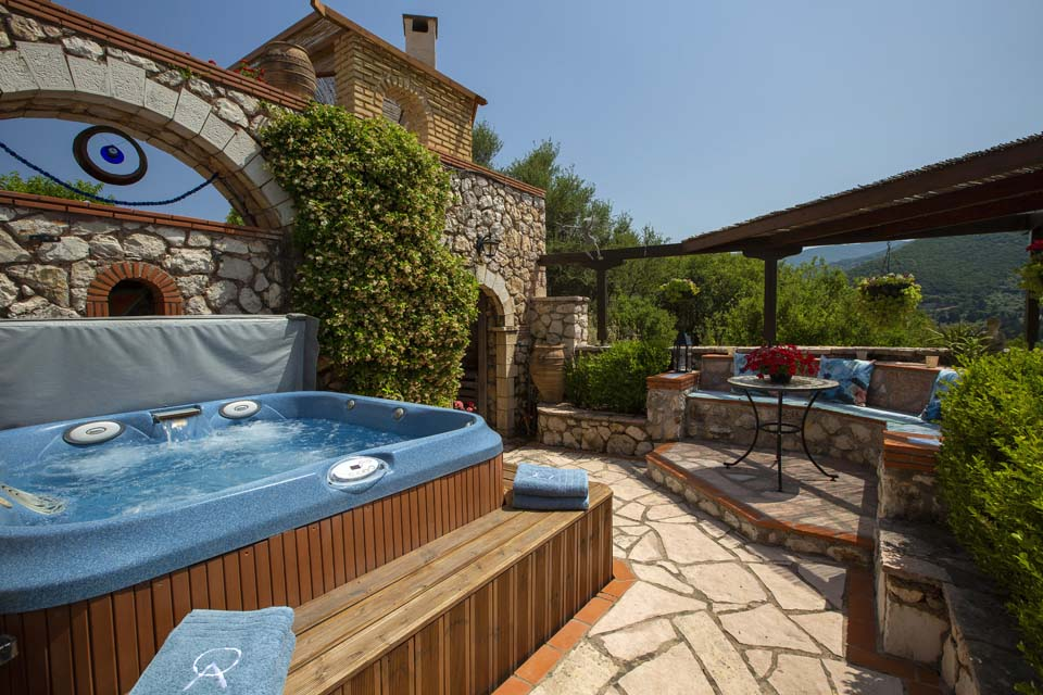 Jacuzzi and seating by day night at Villa Octavius