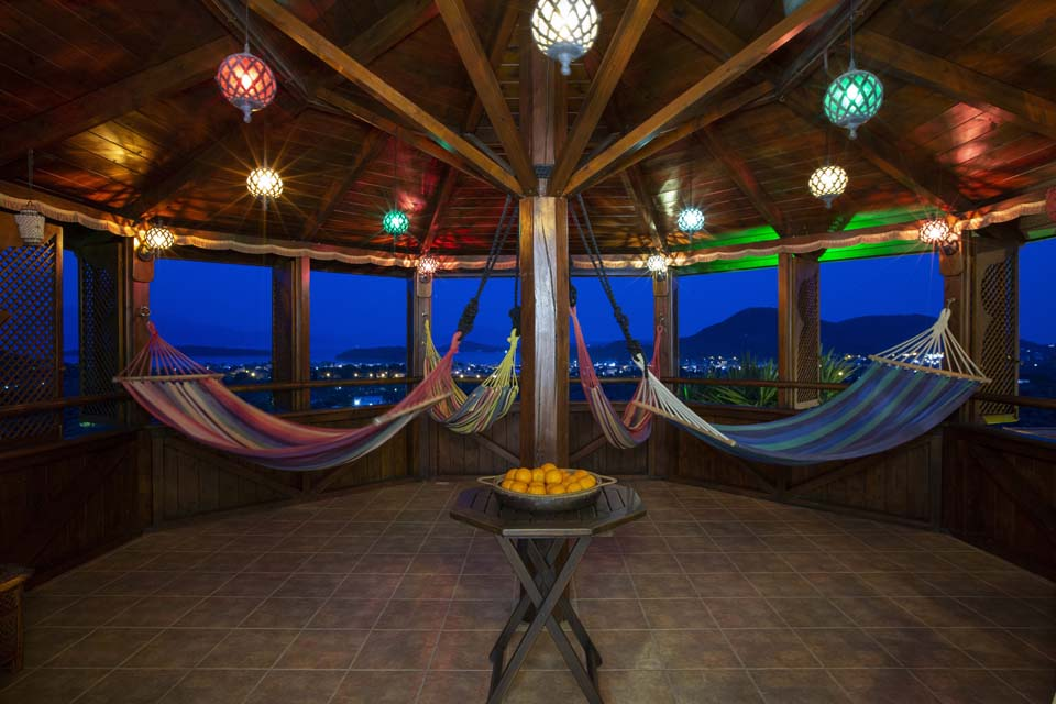 Octagonal Moroccan hammock tower at night at Villa Octavius