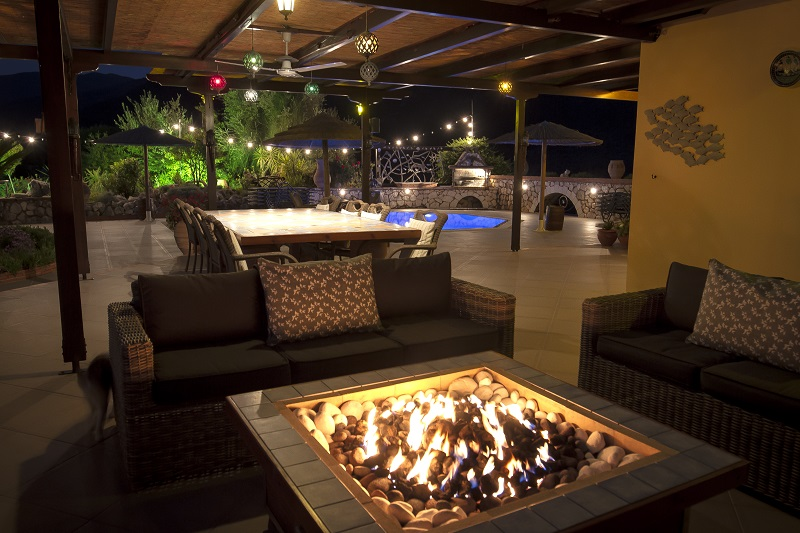 Fire table, terrace, pool and barbecue